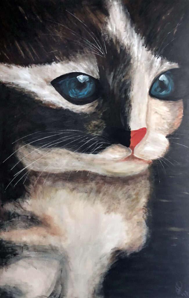 Groot schilderij van een kat