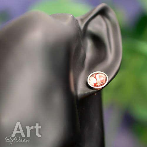 Ovale zilveren unieke oorknopjes rood