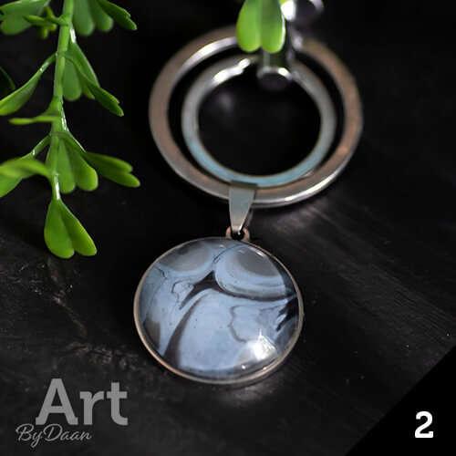 Luxe leren sleutelhanger met blauw / zwarte steen