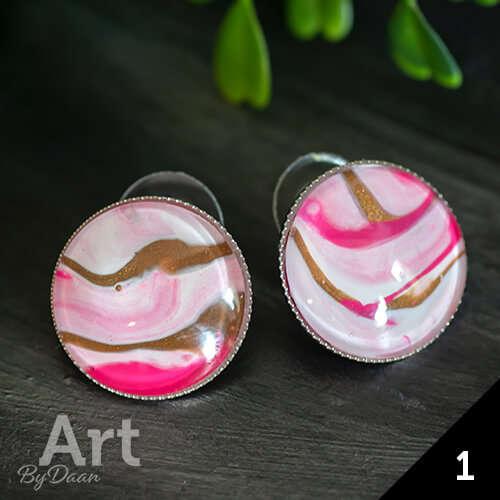 Unieke grote ronde oorknoppen met roze steen
