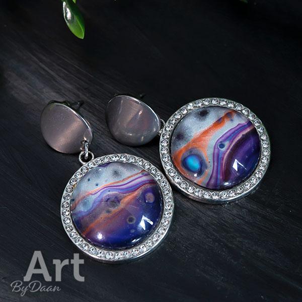 Bijzondere grote oorbellen met zirkonia en paarse handgemaakte stenen