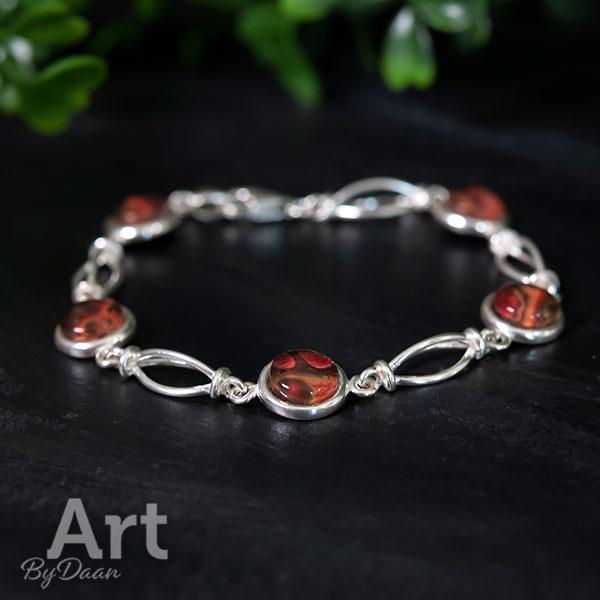 Exclusieve zilveren armband met oranje stenen