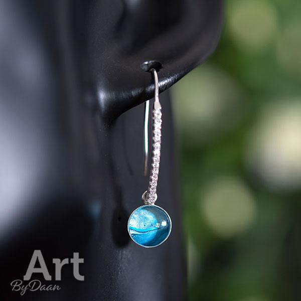 Deftige zilveren oorbellen met zirkonia