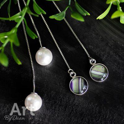 Zilveren doortrekoorbellen met kunstparel