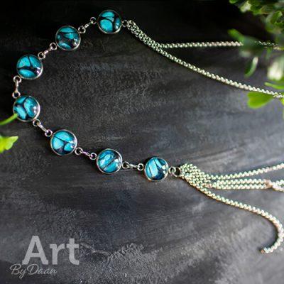 Lange rvs ketting met blauwe stenen
