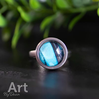 stevige-verstelbare-damesring-met-blauwe-steen.jpg
