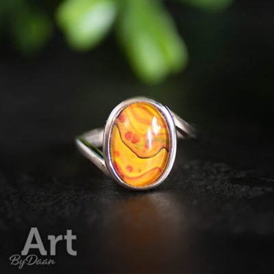 Damesring met oranje steen verstelbaar