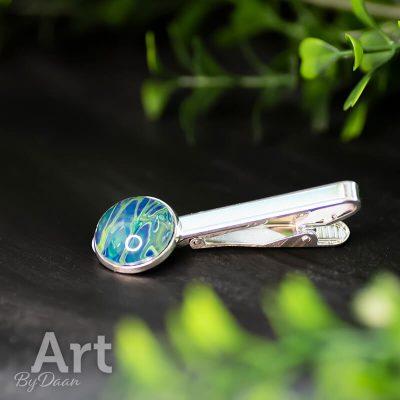 zilverkleurige-dasspeld-met-blauw-groene-steen.jpg